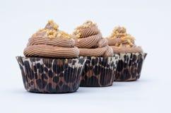 Schokoladenkleine kuchen in Folge Stockbilder