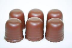 Schokoladenkuß auf weißem Hintergrund Stockbilder