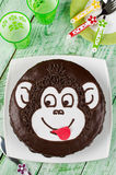 Schokoladenkuchen Affe Stockfoto