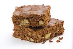 Schokoladenkuchen der heißen Schokolade mit Walnüssen und Vanille Stockfotos