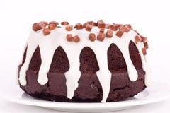 Schokoladenkuchen mit Vanillesoße Lizenzfreie Stockbilder