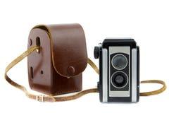Schokoladenkuchenkamera und Kameratasche Stockfoto