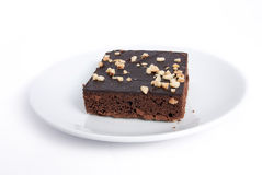 Schokoladenkuchenquadrat auf Plattenteller Lizenzfreie Stockbilder