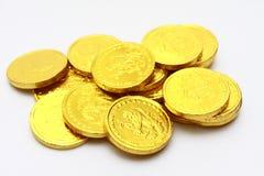 Schokoladenmünzen im Gold Stockfoto
