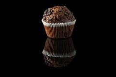 Schokoladenmuffin auf Schwarzem Lizenzfreies Stockbild