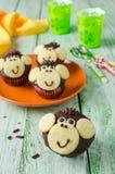 Schokoladenmuffins Affe Lizenzfreie Stockbilder