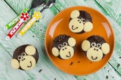 Schokoladenmuffins Affe Stockbild