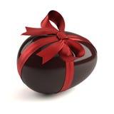 SchokoladenOsterei mit rotem Farbband Lizenzfreies Stockbild