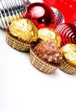 Schokoladensüßigkeit behandelt Thema des Weihnachtsneuen Jahres Stockfoto
