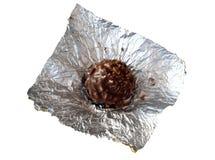 Schokoladensüßigkeit in der silbernen Folie Stockfotos