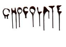 Schokoladensirup, der flüssige süße Nahrungsmittelzeichen leckt Stockfotos