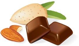 Schokoladenstücke und -mandeln Stockfotos