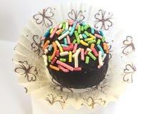 Schokoladentrüffel mit farbigen Pralinen Lizenzfreies Stockbild