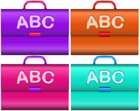 Scholar briefcases. With handle and ABC letters isolated over white background color set Royalty Free Stock Image