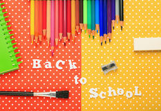 Scholar material to back to school in colored background Stock Photo