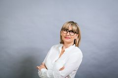 Scholarly attractive woman in glasses Royalty Free Stock Photos