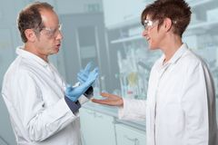 Scholarly debate. Two chemist are discussing what is the best chemical solution for there problem Stock Photos