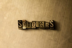 SCHOLARS - close-up of grungy vintage typeset word on metal backdrop Royalty Free Stock Photos