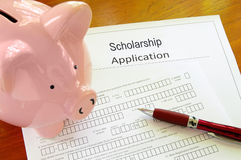 Scholarship application. Blank scholarship application form with piggy bank royalty free stock photos