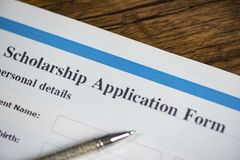 Scholarship application form document contract concept with pen for grants education stock photo