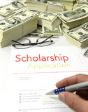 Scholarship application form and money. Scholarship application form and dollar bills stock images