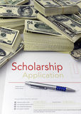 Scholarship application form and money. Scholarship application form and dollar bills stock photo