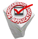 Scholarship Applications College Financial Support Paperwork Sta. Scholarship Applications paperwork stack for you to fill out and apply for merit awards and Royalty Free Stock Photo