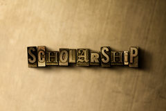 SCHOLARSHIP - close-up of grungy vintage typeset word on metal backdrop Stock Photo