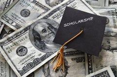 Scholarship graduation cap on cash. Scholarship mini graduation cap on cash stock photography