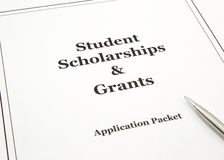 Scholarship and Grants Application Packet. A college scholarship and grant application packet with a pen ready to start stock photos