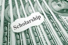 Scholarship money. Scholarship text on paper, over hundred dollar bills Royalty Free Stock Photo