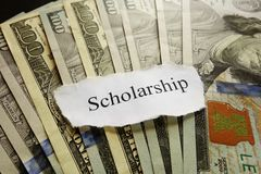 Scholarship paper note. On assorted cash royalty free stock photography