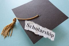 Scholarship. Paper note on a graduation cap royalty free stock image