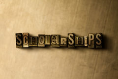 SCHOLARSHIPS - close-up of grungy vintage typeset word on metal backdrop. Royalty free stock illustration.  Can be used for online banner ads and direct mail Royalty Free Stock Photography