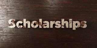 Scholarships - grungy wooden headline on Maple  - 3D rendered royalty free stock image. This image can be used for an online website banner ad or a print Royalty Free Stock Photos