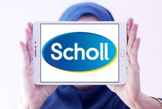 Scholl footcare solutions company logo. Logo of Scholl footcare on samsung tablet holded by arab muslim woman . Scholl provides an ever growing range of footcare Royalty Free Stock Image
