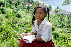 Schollgirl in traditional costume. In amed village bali Stock Photography