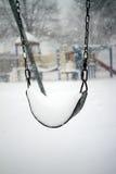 Schommeling in een sneeuwonweer Royalty-vrije Stock Afbeelding