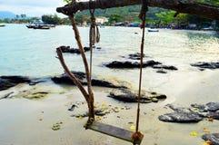 Schommeling op zee Stock Foto's