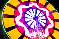 Schommelings lichte kleurrijke achtergrond Foto bij lange blootstelling Stock Afbeelding