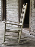 Schommelstoel frame door deur royalty-vrije stock afbeelding