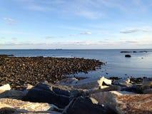 Schommelt at low tide stock foto's