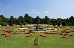 Schonbrunn Palace Gardens at Vienna. Colorful garden with fountain, at Schonbrunn Palace Gardens in Vienna, Austria Royalty Free Stock Photo