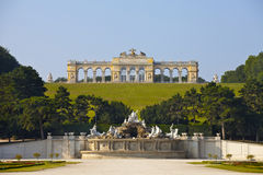 Schonbrunn Palace Gardens at Vienna. View on Gloriette structure and Neptune fountain in Schonbrunn Palace, Vienna, Austria Stock Images