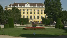 Schonbrunn Palace and its gardens and fountains. VIENNA, AUSTRIA - AUGUST 2016: Travelling in Europe. Architecture of Schloss Schonbrunn (Palace) and its gardens stock video footage