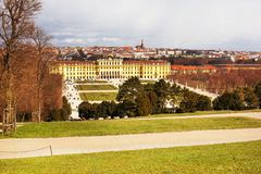 Schonbrunn Palace and tourists walking around. Schonbrunn Palace view and Vienna skyline panorama, Austria Royalty Free Stock Photo