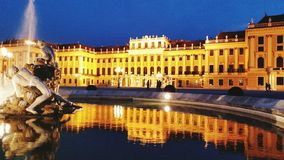 Schonbrunn Palace in Vienna. Schonbrunn Palace lit at night with fountain Royalty Free Stock Photo