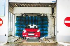 Schone machine, autowasserette met spons en slang Royalty-vrije Stock Fotografie