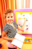School. Small girl in sunny room royalty free stock photos