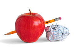 School. Pencil, paper and an apple representing education or school Royalty Free Stock Photos